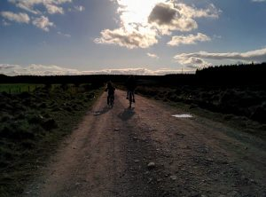 young cyclists in the sunset